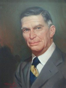 Image of a painting of an older Caucasian man with grey hair wearing a grey suit, white shirt and blue and yellow striped tie.