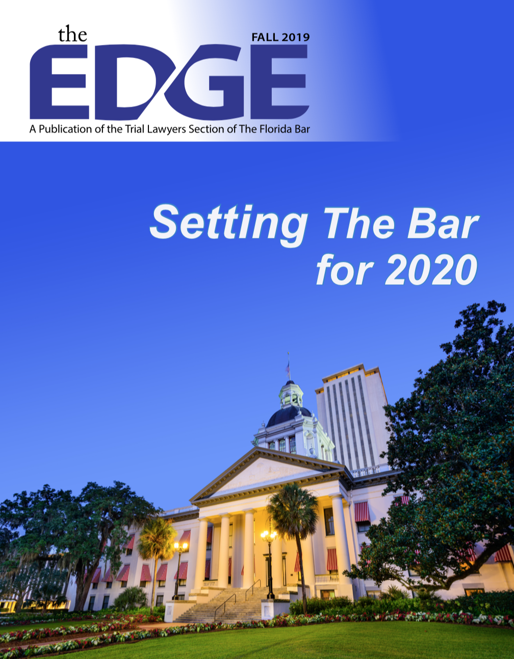 The Edge Magazine Cover Fall 2019, there is a white courthouse building with trees, green grass, red flowers and a blue sky in the background